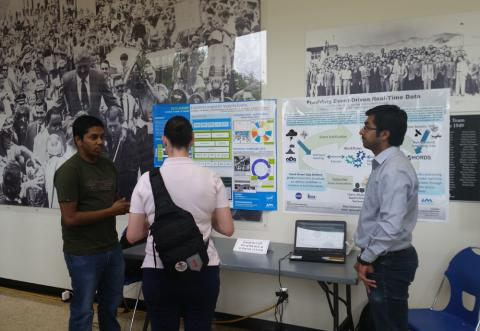 ITSC students Sandip Sahani and Sumeet Kore in front of ITSC DataAlbums and ED3/CHORDS posters