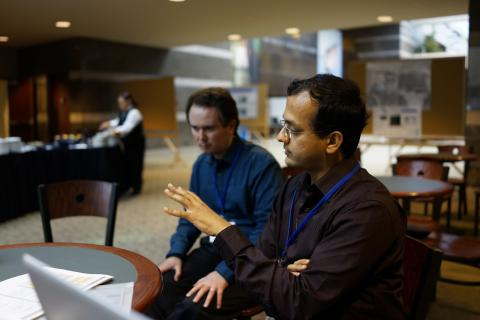 Ajinkya Kulkarni discusses Drupal with colleagues