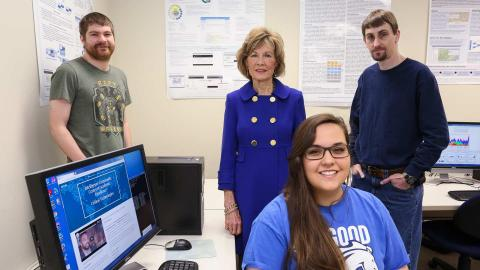 IC CAE Scholar Corinne Peacher, front, and research scientists Jason Toone, left, and Charles Collins, right, with Dr. Sara Graves, center, in the IC CAE laboratory.