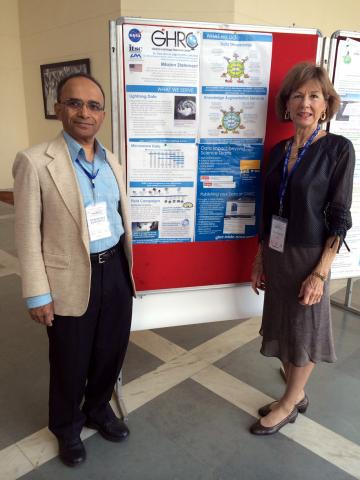 Hampapuram Ramapriyan and Sara Graves stand in front of the GHRC poster at SciDataCon 2014.